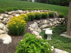Boulders give this small garden area a huge level of personality while serving great function!
