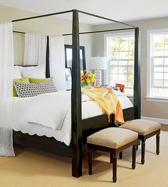 Light and airy bed with pops of color and pattern all set on a neutral grey background.