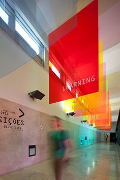 This refracted light signage brings color and impact into the space in a sophisticated manner.