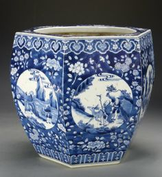 China, 17-18th C., blue and white jar, hexagonal body with flat rim mouth, Ruyi decorated border at the top, with floral designs in deep, rich, blues throughout, medallion on each side with scenes of figures and animals, Kangxi mark on the base. Height: 12 in., Width: 12 in.