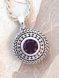 Purple Mystic Topaz Pendant/Necklace by NorthCoastCottage, $89. This 2CT, 8mm faceted mystic #topaz is a fiery #PURPLE that sparks off many colors, set in #sterlingsilver, true heirloom-quality. Topaz is the November #birthstone; a #gemstone for #Leo, #Scorpio & #Sagittarius; and a 23rd #anniversary #gemstone. Purple variety vibrates to the third eye #chakra (6th, Ajna) and aids #meditation. Topaz is said to strengthen faith & optimism, attract helpful people, & bestow charisma & confidence!
