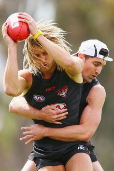 Dyson Heppell of the Bombers is tackled by David Myers during an Essendon Bomber AFL pre-season training session at True Value Solar Centre on November 7, 2016 in Melbourne, Australia.
