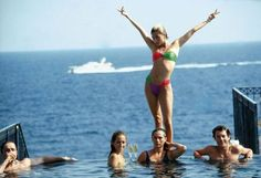 Marie Chantal Miller,strikes an extravagant pose above her sister Pia (in yellow). They are lounging in the pool of the Hotel Belair, Cap Ferrat, July Slim Aarons, Saint Tropez, Grace Kelly, Royal News, Best Yachts, Hotel Bel Air, Carlton Hotel, Nostalgia, Sands Hotel