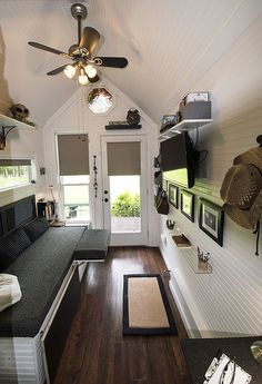 I love how the seating folds up/down to make another sleeping area.  Mendy's Shoebox Tiny Home