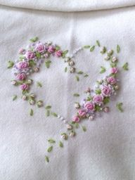 Embroidered flowers/heart - would make such pretty bedsheets!