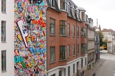 By Martin Whatson in Aalborg, Denmark Little Green House, Street Art Utopia, Aalborg, Kinds Of Colors, High Walls, Red Roof, 4 Photos, Street Artists, Gray Background