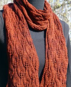 "Free Knitting Pattern for Amy Pond Scarf - This leaf lace scarf was inspired by the long red lace scarf Amy Pond wears in season 5 of Dr. Who (""The Vampires of Venice"" and ""Vincent and the Doctor"") and uses a stitch from Barbara Walker's Treasury of Knitting Patterns. Fingering weight yarn. Designed by Tamara Moots"