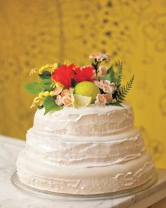 This carrot-coconut cake was topped by antique fabric blossoms, red hibiscus flowers, lime slices, and greenery
