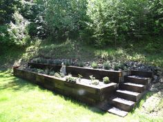 Railroad tie raised garden. Two tiers with stairs on each side!