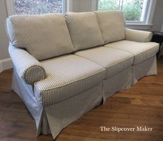 Ticking stripe sleeper sofa slipcover in black and natural.  Click photo to the see the before.