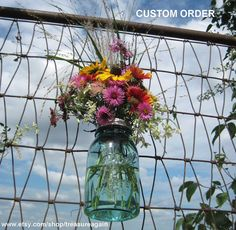 Could use wildflowers for the second reception/party.   Google Image Result for http://img0.etsystatic.com/000/0/5814553/il_fullxfull.287998440.jpg