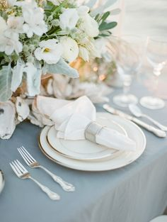Coastal tablescape with oyster shell garland as a tabe runner | Soft and Romantic Emerald Coast Wedding Inspiration | The Jacksons Photography