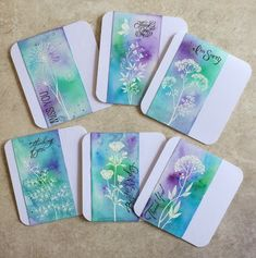 handmade notecard set from Chocolate Baroque Challenge Blog ... color challenge ... emboss resist ... white embossed field flowers ... Brushos watercolor powders in green blue and purple ... luv these colors ...