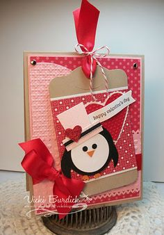 "Penguin Card! Punches:  •Body - Black 1 3/4"" circle, white  1 3/8"" circle punch  •Flippers - large oval punch; punch once and then move it over and punch again  •Feet - Owl punch in Pumpkin pie card stock  •Eyes - Cupcake punch  •Beak - Heart to Heart punch - trim off top of heart  •Hat - 1"" square punch for the top (trimmed slightly at an angle) and 1 3/8"" for the hat brim  •Heart on hat - small heart punch in Red glimmer card stock"