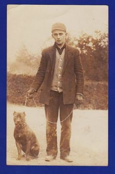 1909 Young Man with Pitbull Dog Vintage RPPC postcard