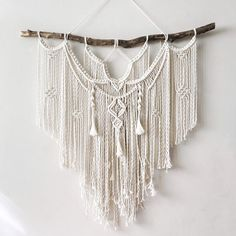 Large Macrame Wall hanging Dope Rope is home to modern-bohemian wall hangings that are meant to bring texture and dimension to any wall or room in your house. Your piece is made by hand using natural unbleached cotton and driftwood and local branches from woods in Upstate NY and the