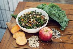 Kale salad with wild rice, kale, chicken breast, goat cheese, apple, sweet potato, almonds - from the coveteur