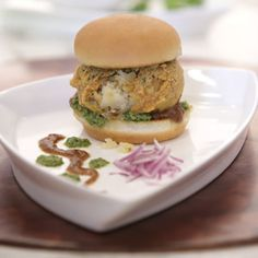 Vada Pav - Spicy Indian Vegetarian fast food dish made with deep fried mashed potatoes