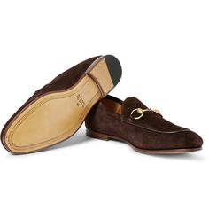 Sleek, well-made loafers exude confidence and luxury in equal measure. Meticulously crafted in Italy from dark-brown suede, this Gucci pair has leather trims and burnished-gold horsebit details, referencing the label's equestrian heritage. Wear yours with trim navy trousers or dark jeans.