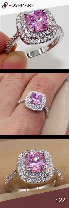 LARGE PINK STONE SURROUNDED BY CZ's.      Sz.9 Brand new pink and white CZ stones. Band is 18k white gold plated. Jewelry Rings
