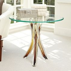 Glass Tusk Table The Perfect Table For Your Home! #tables #homedecor #interiors #design #interiorhomescapes #interiorhomescapes.com #interior homescapes