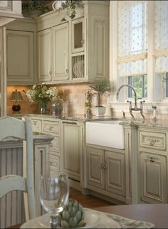 I love this kitchen, Cabinet color, lighting, the country/colonial feel. No dark kitchens for me!
