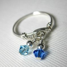 Hey, I found this really awesome Etsy listing at https://www.etsy.com/listing/99819860/dangle-ring-sapphire-and-aquamarine