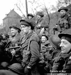 Canadians in Germany - Infantrymen of the Royal Winnipeg Rifles in a Buffalo amphibious vehicle taking part in Operation VERITABLE en route from Niel to Keeken, Germany. February 9, 1945.