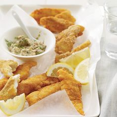 Crunchy Fish Sticks with Tartar Sauce | Michael Schlow of Radius in Boston uses potato flakes from a box in place of bread crumbs to form a supercrispy crust for cod fillets.