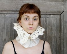 Item Details        (101)   Shipping & Policies Nuno felted collar, white ruff, neck warmer with frill , decorated with vintage glass buttons like crystal . I felted it with delicate natural white merino wool and beautiful vintage cotton textile with silver fibers. White ecru with silver shine. You can wear it in different way - frill up or down,fastened to the side, front or back of the neck Warm, light and elegant!