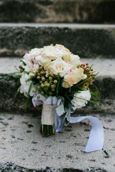 Beautiful styling on this bouquet, tied with a blue ribbon.