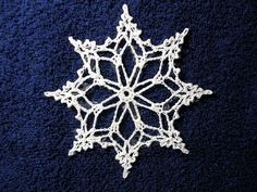 Snowflake Ornament:  Free pattern for this cutie.  This one looks less detailed, for mass production (in case you like to use them to decorate packages or give to everyone you know)...