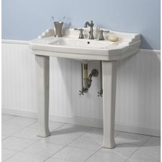 The size and style of this console sink make it a practical choice for a stylish guest bathroom.
