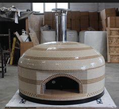 """The Vesuvio100 pizza oven is an Italian style fully assembled 40"""" oven for indoor or outdoor kitchens. Hand tiled with fuel efficient center vent design."""