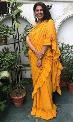 The Stylish And Elegant Ruffle Saree In Yellow Colour Looks Stunning And Gorgeous With Trendy And Fashionable Cotton Silk Fabric Looks Extremely Attractive And Can Add Charm To Any Occasion. Simple Sarees, Trendy Sarees, Stylish Sarees, Indian Dresses, Indian Outfits, Formal Saree, Saree Look, Indian Attire, Indian Wear