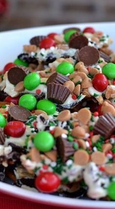 Christmas Bark Cookie Crunch. 1 lb. white chocolate (I use Ghirardelli white chocolate chips), 14 Oreos, broken into pieces (I use the plain), 1 and 1/2 cups pretzels, broken- I used the thin straight ones, 1 cup peanut butter chips, 1/2 cup peanuts, 1/2 cup miniature Reese's cups, 1/2 cup Peanut M&Ms (Christmas Colors), Christmas sprinkles.
