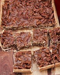 "These delightful nut bars, inspired by a recipe from Ken Oringer's mother-in-law, are both gooey and crisp. Oringer sometimes adds a pinch of curry powder to the caramel because, he says, ""I like for people to bite into these and wonder what the spice is. I love that element of surprise."""