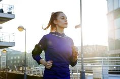 Female runner running in urban environment. - Betsie Van Der Meer/Taxi/Getty Images