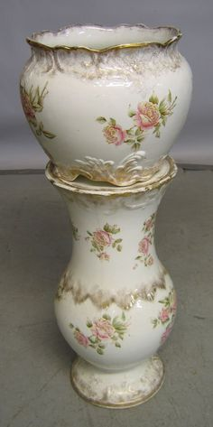 Porcelain jardiniere on stand  Decorated with transfer-print flowers and gilt details. Marked: Warvick china. H: 35 in.
