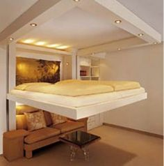 Bed lowers from ceiling electrically for those small spaces.  Check out how the couch stays in place.