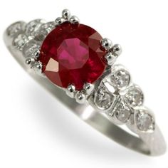 Luscious Ruby Jewel: Glowing. Vivid. Lustrous. Words cannot describe the shining true red fire of this fine natural Burmese ruby. This natural marvel has been set into a lovely platinum and diamond mounting with just enough sparkle to highlight the ruby.  Ca 1930.  Maloys.com