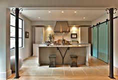 Unbelievable, sleek kitchen.  Pantry 12feet behind barn doors.  houses fridge and food and appliances.  designer Emily Bourgeois