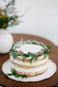 The rosemary and pomegranate seeds on this gorgeous cake are a chic way to incorporate traditional holiday colors. The rosemary and pomegranate seeds on this gorgeous cake are a chic way to incorporate traditional holiday colors. Holiday Cakes, Christmas Desserts, Holiday Treats, Christmas Treats, Holiday Recipes, Christmas Cakes, Christmas Recipes, Christmas Birthday Cake, Christmas Cake Decorations