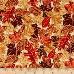 East Grove Metallic Packed Leaves Cream from @fabricdotcom  From Hoffman California International Fabrics, this cotton print is perfect for quilting, apparel and home decor accents. Colors include cream, shades of red, and shades of brown with gold metallic accents.