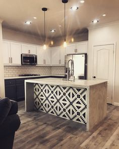 What a fun & unique idea to put patterned cement tile on the kitchen island!