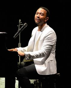 John Legend performs at Mizner Park Amphitheatre in Boca Raton, Florida, on July 27, 2014
