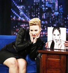 Making fun of her own album cover. Demi lovato everyone!!!!!