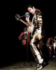 Elvis on stage in Toronto ( Canada ) afternoon show, wearing the legendary gold suit in april 2 1957