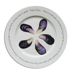 "Fruits de Mer Presentation Plates | 12"" Presentation Plate - Mussel  This 12"" plate has become a classic. Its striking Mussel design is guaranteed to impress your dinner guests.  Dishwasher and microwave safe."