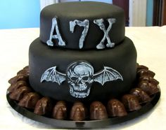 A7X Cake #A7X- for Roberts bday except white with black death bat and black writing